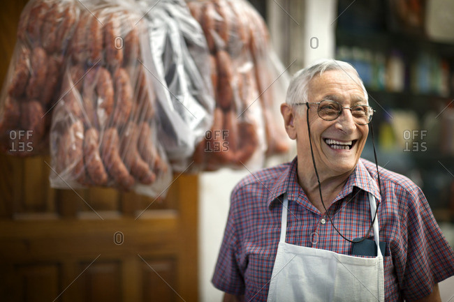 Smiling butcher working in his shop.