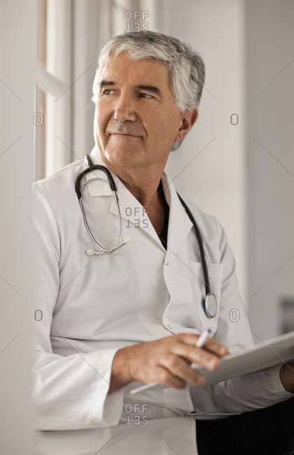 Doctor holding a file.