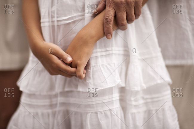 Young girl wearing a white dress.