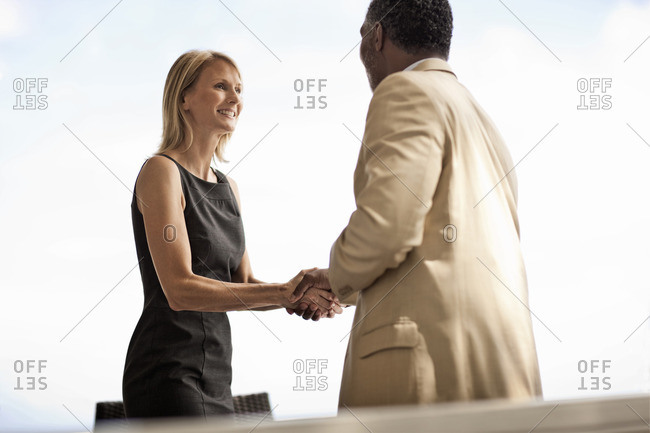 Business colleagues greeting each other with a handshake.