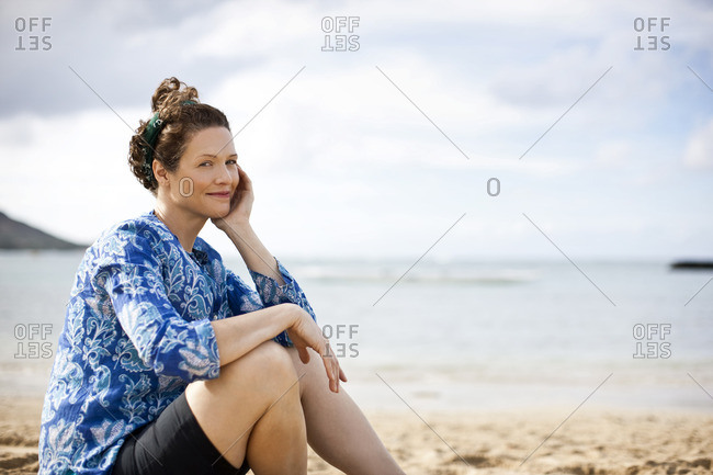 Woman sitting on the beach.