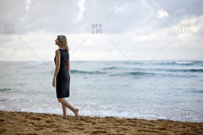 Woman walking along the beach.