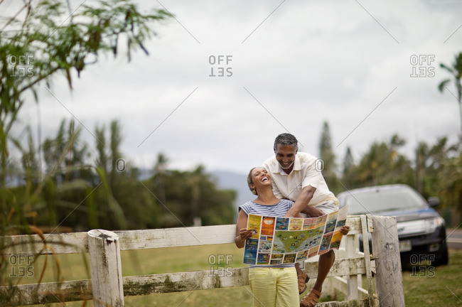 December 7, 2016: Couple looking at a map while on a road trip.