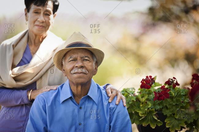 Senior couple in their garden.