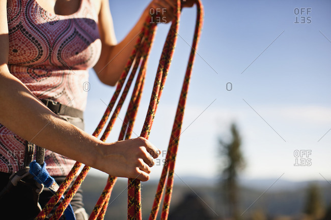 Rock climber holding a rope.