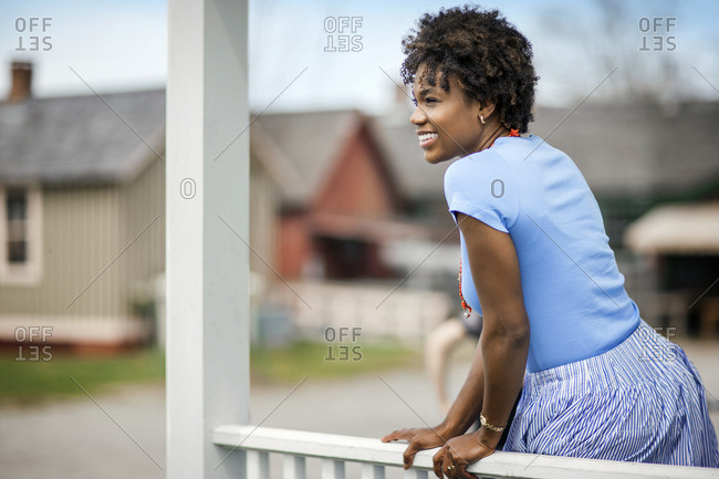 Young woman on a cabin porch.