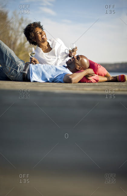 Couple relaxing together with a glass of wine.