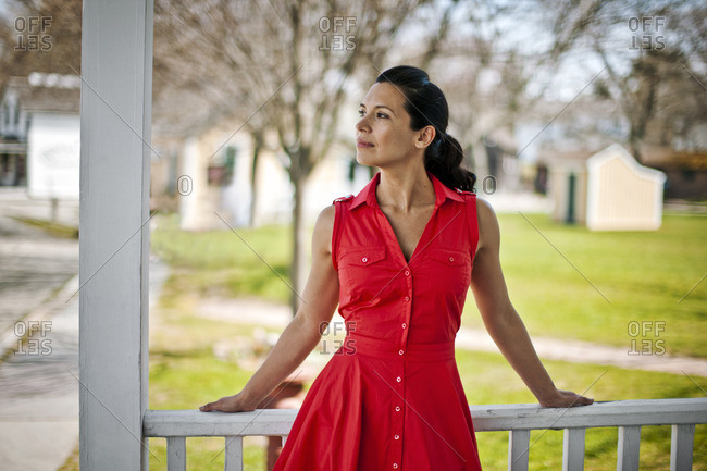 Young woman in a retro red dress.
