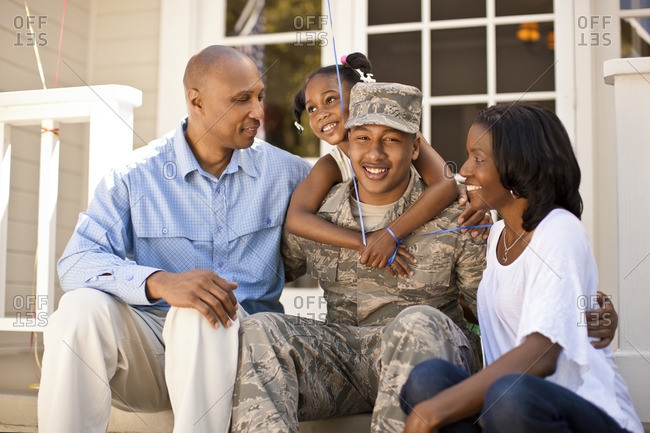Young soldier with his family after returning home.