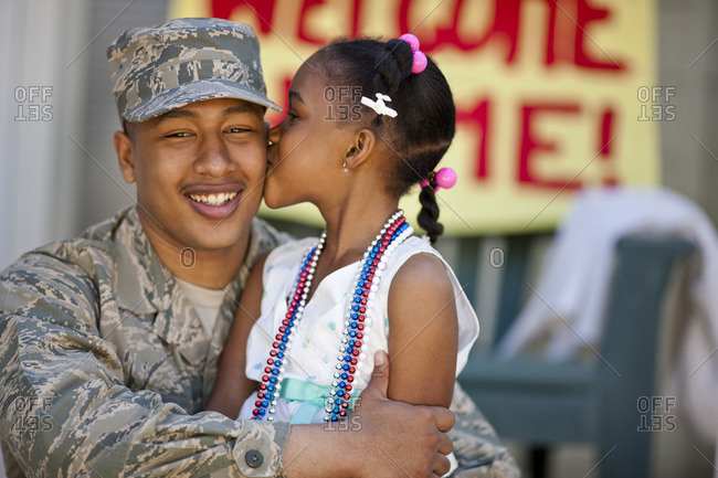 Returned soldier reunited with his young daughter.