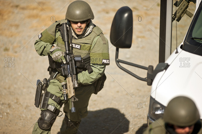 Military police carrying weapons.