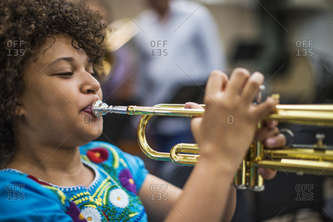 Young girl playing the trombone.