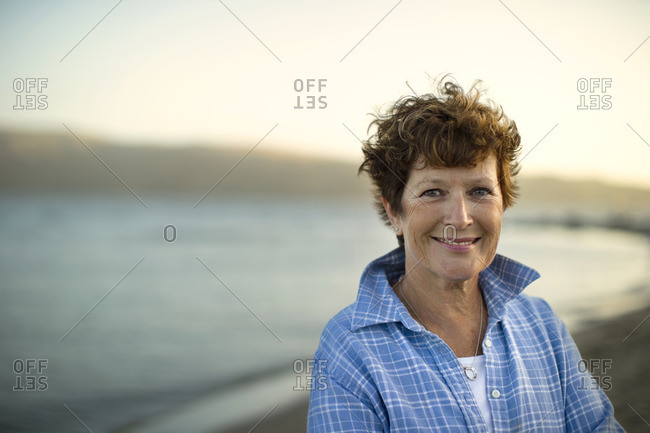 Smiling woman on the beach.