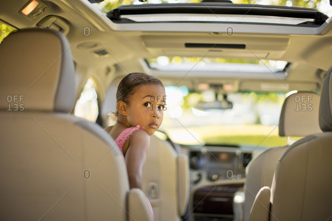 Young girl waiting in the car to set off for a ballet lesson.