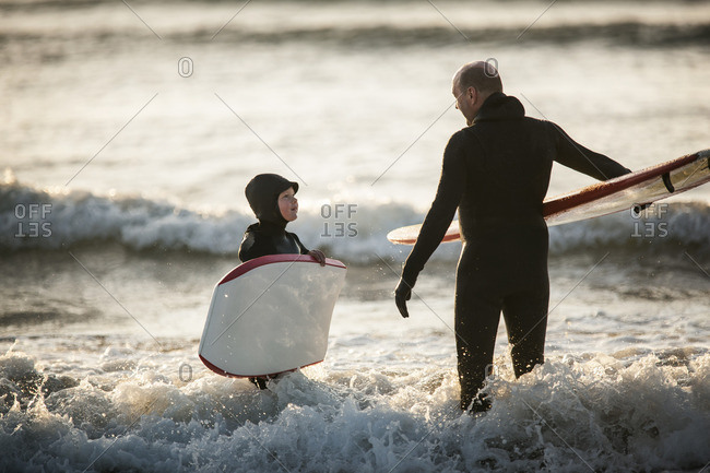 Father and son surfing and bodyboarding together.