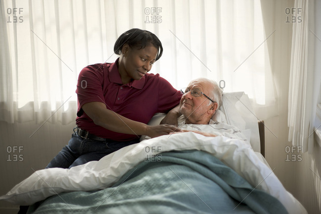 Senior man receiving a visitor while unwell.