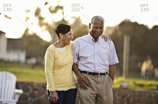 Senior couple walking happily together.