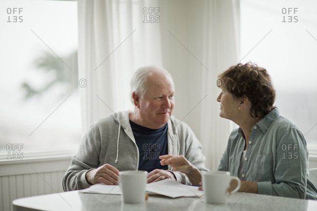 Senior couple looking over paperwork.