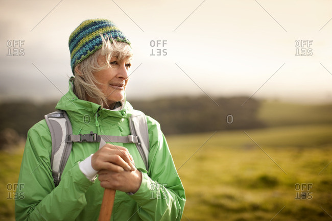 Woman admiring the view while out on a hike.