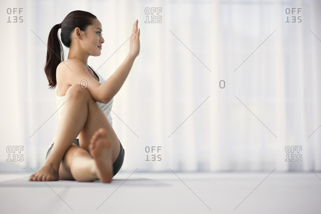 Young woman stretching during a yoga practice.