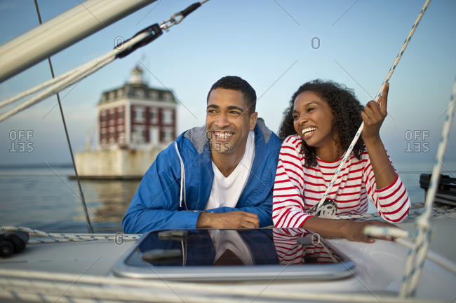 Young couple boating together.
