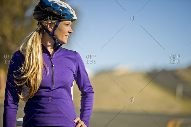 Young woman admiring the view while out on a bike ride.
