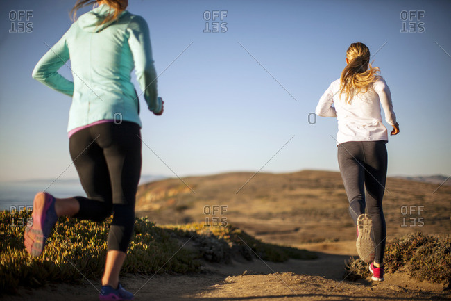 Two friends jogging together.