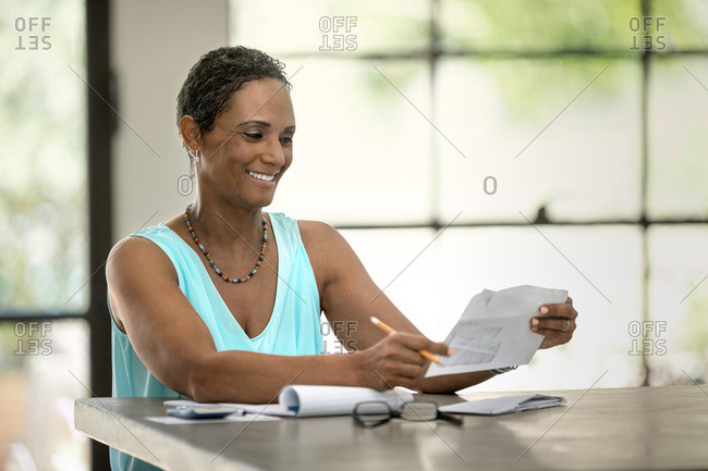 Woman looking at her household bills.