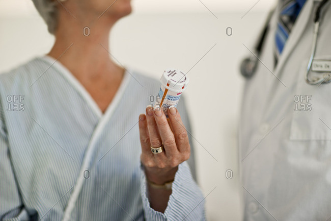 Patient discussing medication with her doctor.