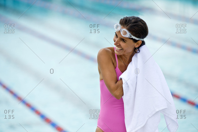 Woman toweling off after a swim in the pool