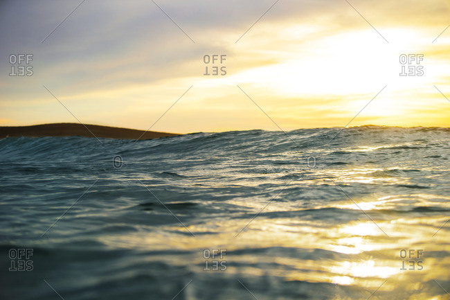 Waves on the ocean at sunset.