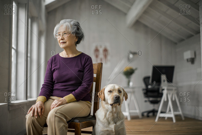 Senior woman sitting with her dog.