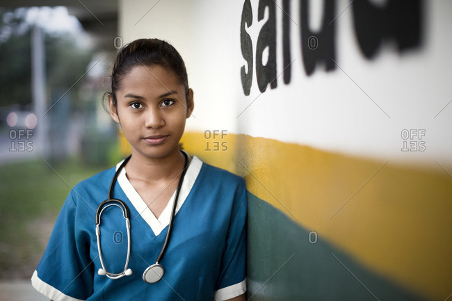 Young nurse standing outside the hospital.