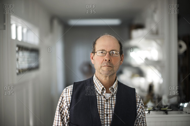 Senior man in his kitchen.