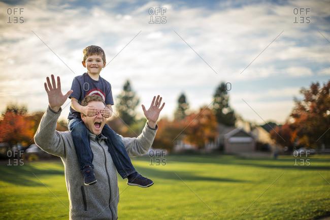 Father giving his son a piggyback.