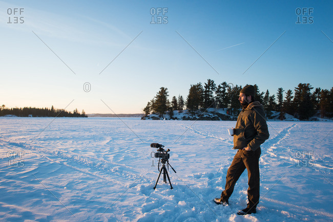 Portrait of a photographer on frozen winter lake
