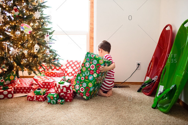 Boy looking at his presents on Christmas morning