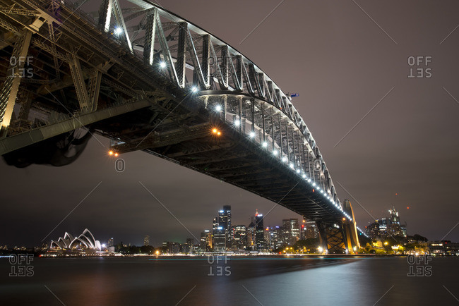 Sydney, Australia - December 12, 2015: Sydney Harbor and bridge illuminated at night, Sydney Australia