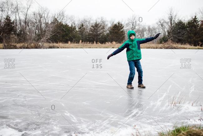 Boy on a frozen pond