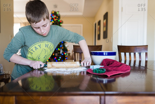 Boy rolling out dough at Christmastime