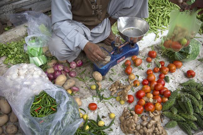 Vegetable vendor in street, India