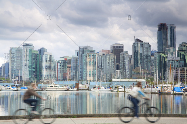 Vancouver, Canada - April 4, 2015: English Bay skyline and cyclists