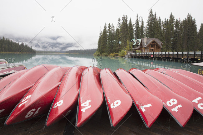 Canoes by a lake in rural setting