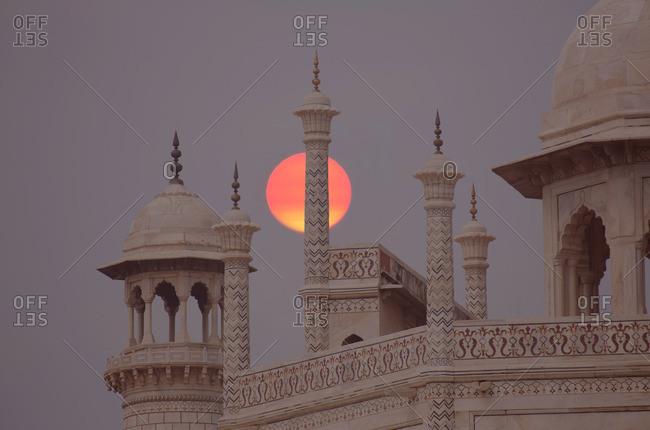 Sun setting by the Taj Mahal