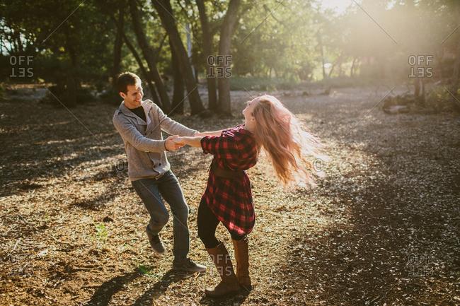 Loving couple dancing in woods