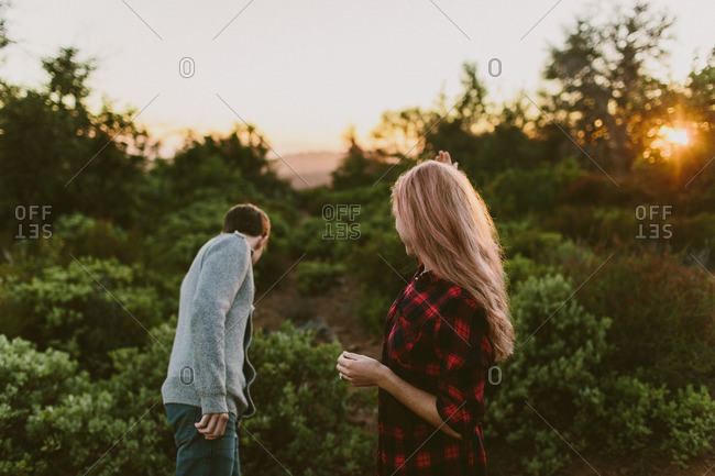 Couple in autumn rural setting at sunset