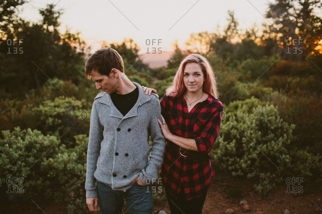 Woman standing close to man in rural sunset