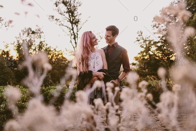 Loving couple smiling in rural field