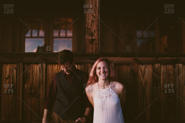 Happy couple in front of cabin
