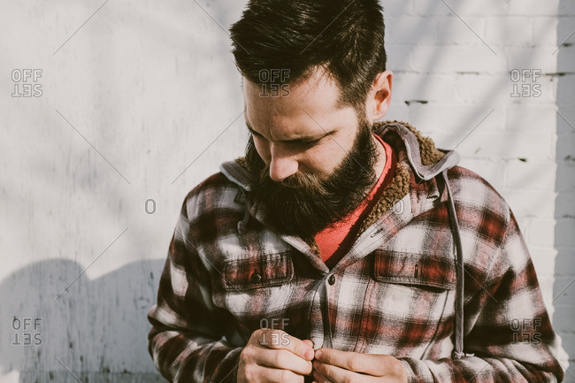 Man with beard in a flannel shirt